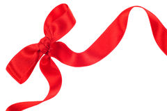 Red ribbon with bow on white Royalty Free Stock Photography