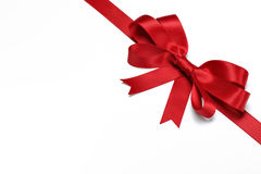 Red ribbon with bow on white Royalty Free Stock Images