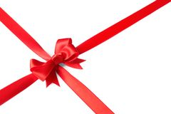 Red ribbon with bow on white background. Festive decoration stock images