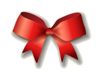 Red ribbon bow on white background. Royalty Free Stock Photos
