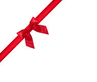 Red ribbon bow on white background. Royalty Free Stock Photo