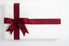 Red ribbon bow on white gift Stock Images