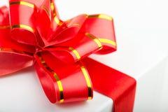 Red  Ribbon Bow. On white gift Stock Photos
