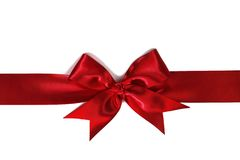 Red ribbon with bow on white Royalty Free Stock Image