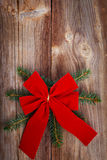 Red ribbon bow on wooden board Stock Image