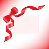 Red ribbon with a card Royalty Free Stock Images