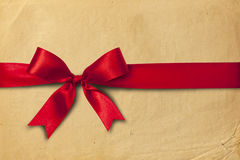 Red ribbon and cartoon box. Red ribbon and bow on the cartoon box Royalty Free Stock Photos