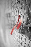 Red ribbon on chain link fence Royalty Free Stock Photos