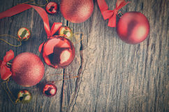 Red ribbon and Christmas balls Stock Photos