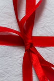 Red ribbon on a Christmas gift Royalty Free Stock Images