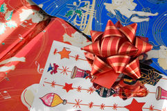 Red ribbon on Christmas paper Stock Photography