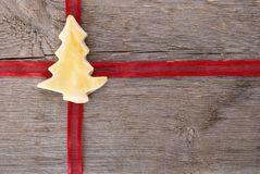 Red ribbon with christmas tree cookie Royalty Free Stock Photo