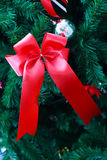 Red ribbon Closeup  from Christmas tree. Stock Photo