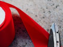 The red ribbon is cut in solemn occasions. The red ribbon is cut on ceremonial occasions in the construction of large-scale projects or long or complex buildings Royalty Free Stock Image