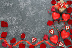 Red ribbon and decorative heart Stock Photos