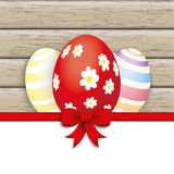 Red Ribbon 3 Easter Eggs. 3 easter eggs on the wooden background Stock Photography