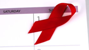 Red ribbon falling on a calendar stock video