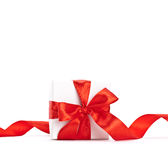 Red ribbon on gift Royalty Free Stock Image