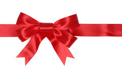 Red ribbon gift with bow for gifts on Christmas or Valentines da. Y isolated on a white background royalty free stock images