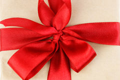 Red ribbon on gift box closeup. The Gift box with red ribbon bow top view Stock Photography
