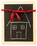 Red Ribbon Gift House Stock Photography