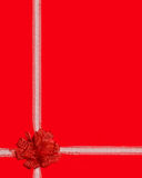 Red ribbon gift wrap. White strap and red ribbon gift wrap on red background (space Royalty Free Stock Image