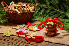 Red ribbon and gingerbread cookies for Christmas Stock Images