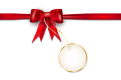 Red ribbon and golden price tag Stock Photography