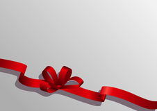 Red ribbon with  on a gray background Stock Photos
