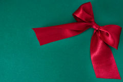 Red ribbon. On green background Stock Images