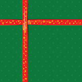 Red Ribbon on green color paper for Christmas festival Royalty Free Stock Photo