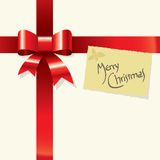 Red ribbon and greetings card Royalty Free Stock Photo