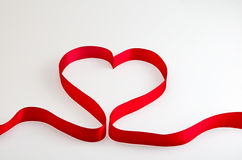 Red ribbon heart Stock Photography