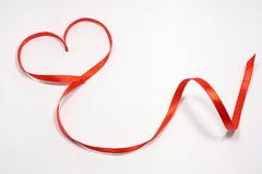 Red ribbon with heart Royalty Free Stock Photography