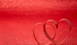 Red Ribbon Heart. Red background royalty free stock image