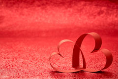 Red Ribbon Heart. Red background royalty free stock photo