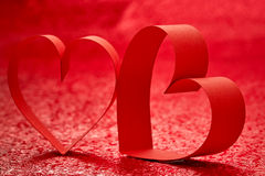 Red Ribbon Heart. Red background stock image