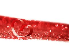 Red ribbon heart on glitters Stock Image