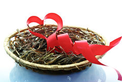The red ribbon, the heart, love is in the basket of isolated on a white background Royalty Free Stock Photography