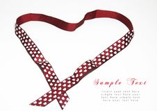 Red ribbon with heart shape Stock Photos