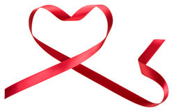 Red ribbon in heart shape. Isolated on white Royalty Free Stock Photography