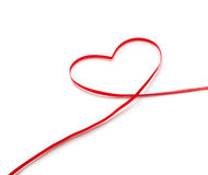 Red ribbon in heart shape Royalty Free Stock Image