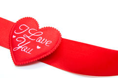 Red ribbon in heart shape Royalty Free Stock Images