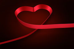 Red ribbon in a heart shape Stock Image