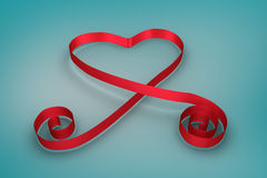 Red ribbon in a heart shape Royalty Free Stock Photo