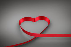 Red ribbon in a heart shape Royalty Free Stock Photos
