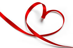 Red ribbon in heart shape royalty free stock photography