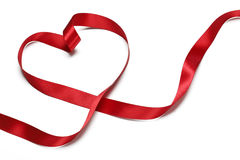 Red ribbon in heart shape Stock Images
