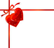 Red ribbon and hearts. Page corner with red ribbon and two hearts label. Place for copy/text Stock Photography