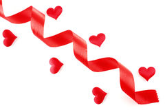 Red ribbon with hearts Royalty Free Stock Photo